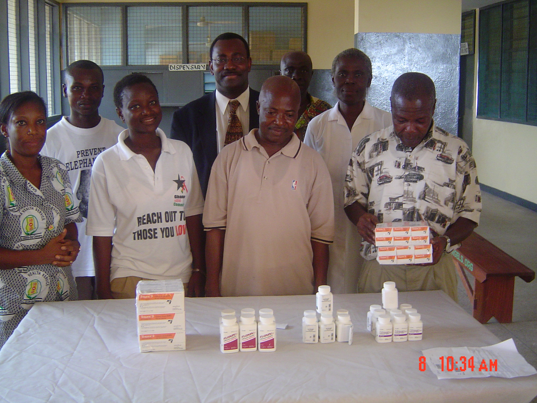 Dr. Thad Ulzen, EAUMF Co-Chair (4th from left) with staff of Elmina Urban Health Centre after donation of drugs on behalf of the Edward A. Ulzen Memorial Foundation.[December 2005]