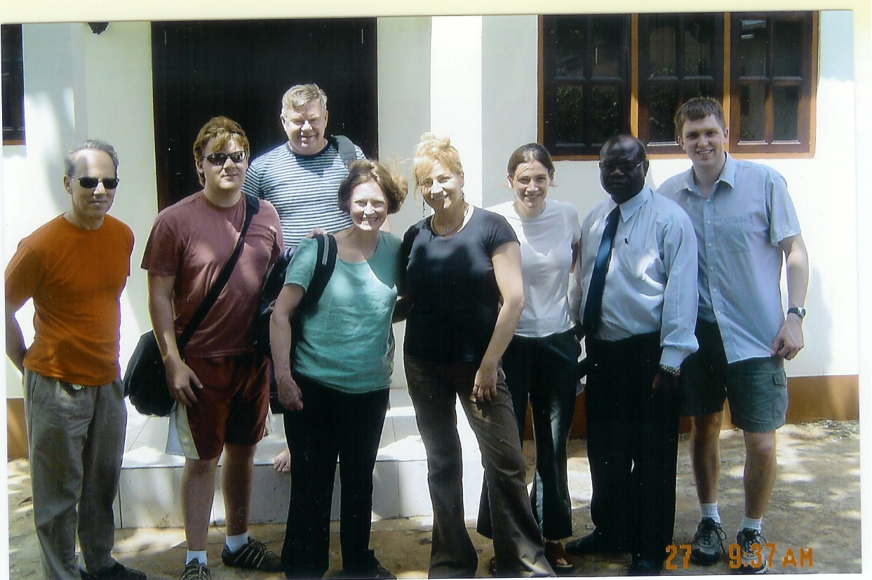 Dr. Tula Petridou [Family physician, UWV], fourth from  right, welcomes the new group of volunteers as she prepares to leave Ghana after a 4 -week stay in Elmina.
