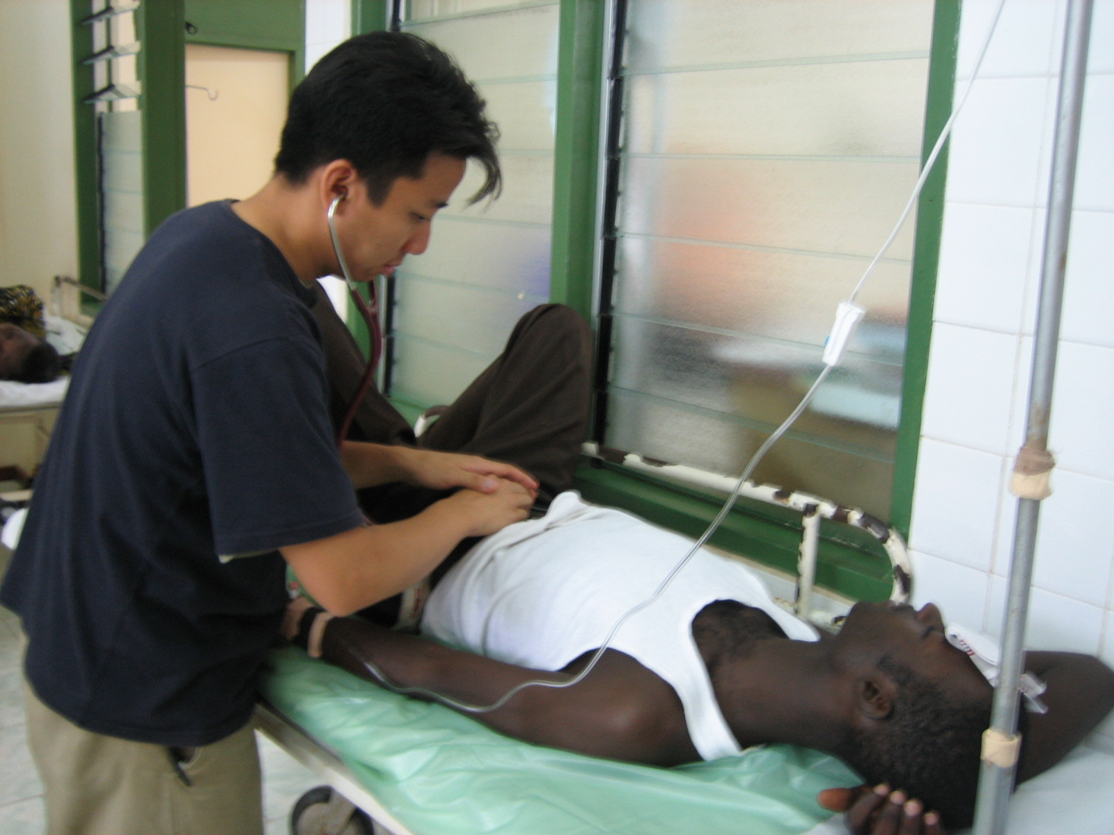Dr. Richard Kwun (Mount Sinai, NY) treating a patient with an incarcerated hernia as an EAUMF volunteer in 2005