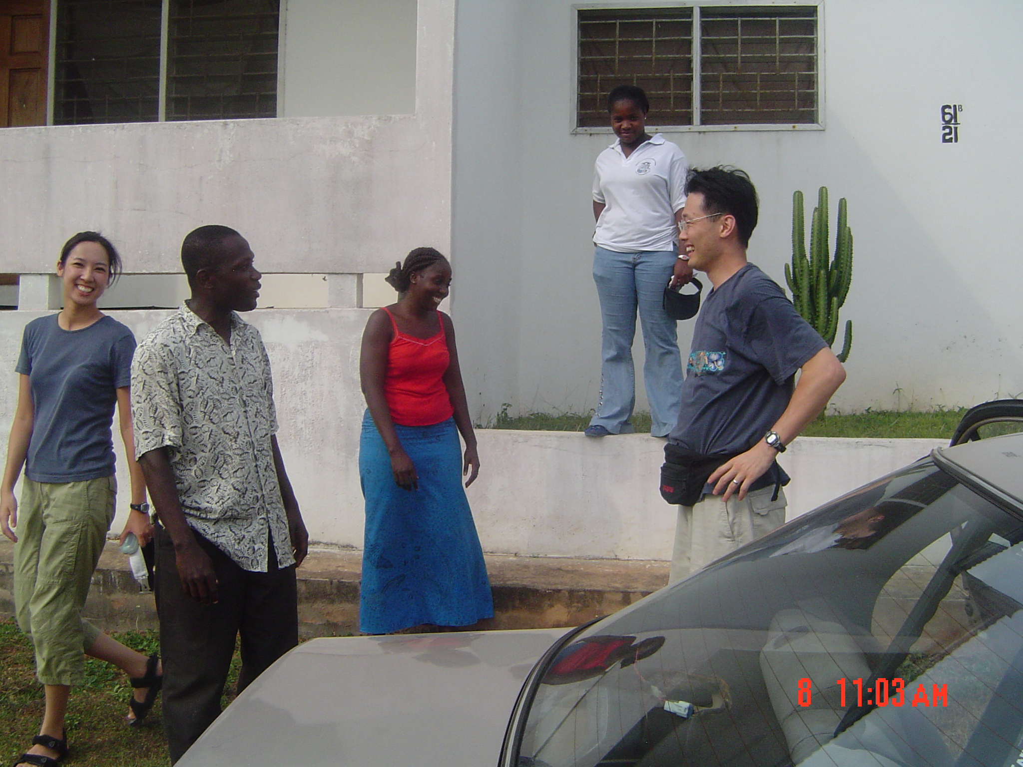 Husband and wife team, Drs. Davis Lee (Peds) and Janet Yang (Internist)from Cedars Sinai Hospital, Los Angeles, saying ther good-byes to Francis Obeng,Lucy Cofie [EAUMF Administrator]and Mercy Cofie in Elmina after volunteering in the EAUMF Program for 1 month. [December 2005].