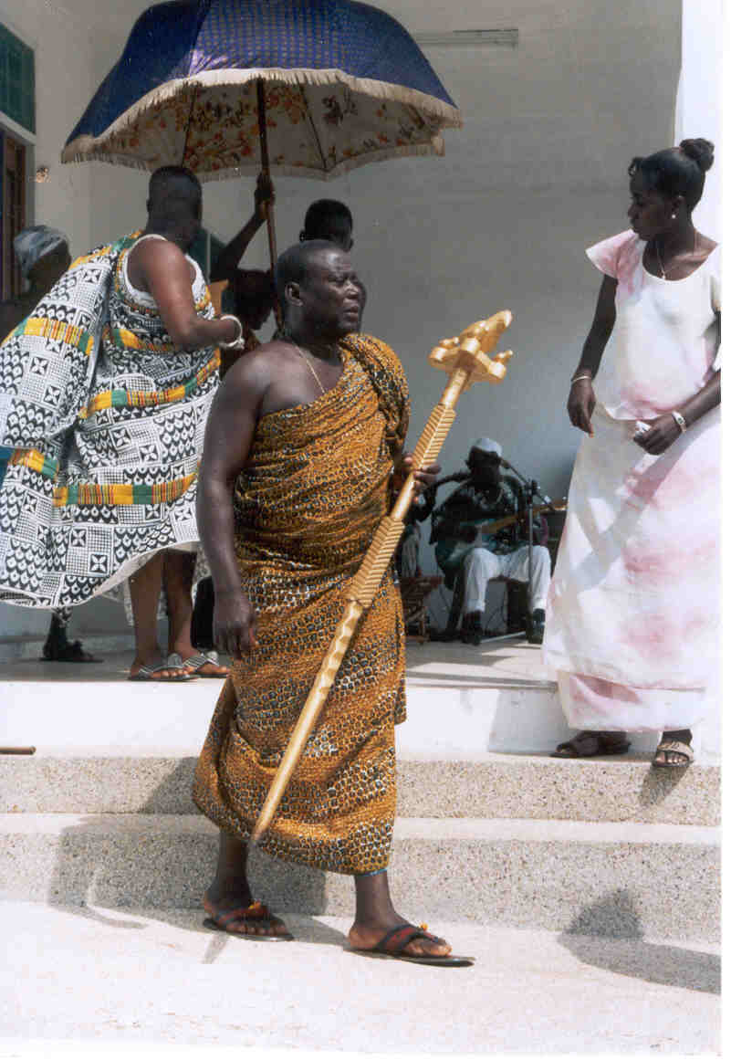 Linguist of the King of Ashanti's delegation to the official opening of Elmina - Java Museum. Looking on is Mrs Lucy Obeng, Curator of the Museum.